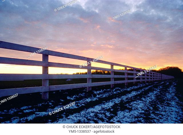 Sunset and farm fence in Northern Illinois, USA