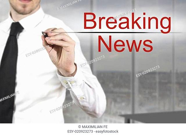 businessman writing breaking news in the air