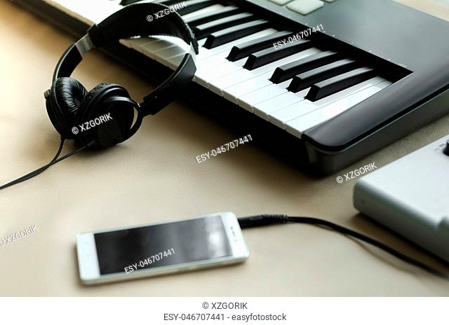Headphones, synthesizer, music console and a telephone