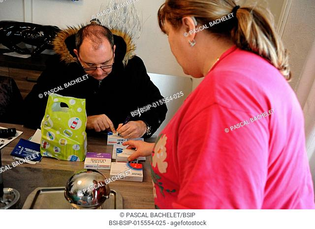 Reportage on a rural pharmacy technician during his home delivery round in Auxi-le-Château, France. Visiting a visually-impaired patient