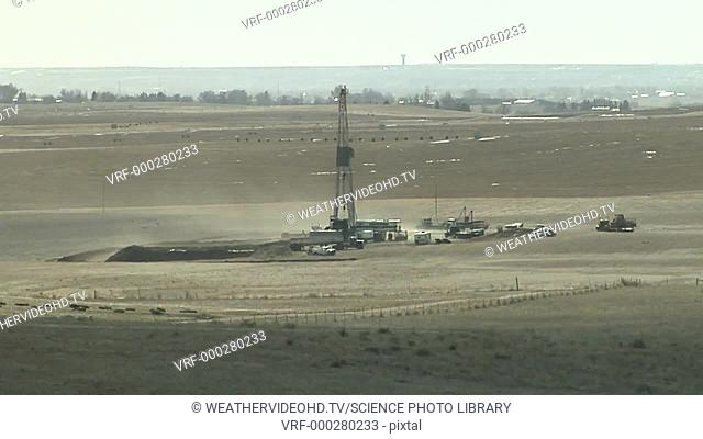 Timelapse footage of strong winds carrying away loose soil from a drilling operation. Filmed in Colorado, USA, in winter