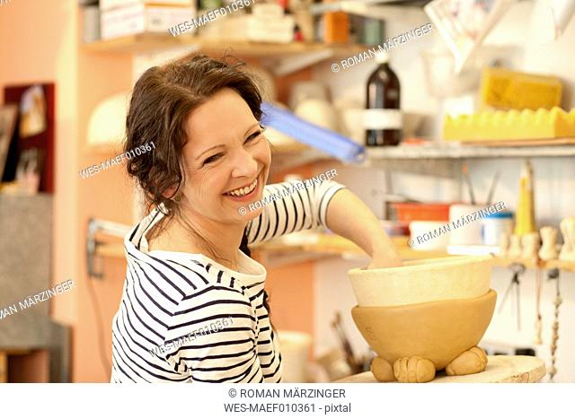 Portrait of smiling potter in studio