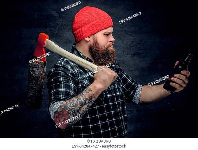 b3503749248 Brutal bearded lumberjack wearing green plaid shirt and red hat
