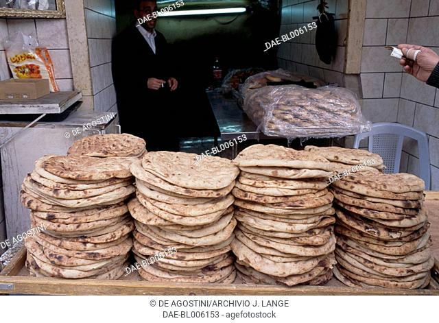 Bread for sale in the souk of the Muslim Quarter, Jerusalem, Israel
