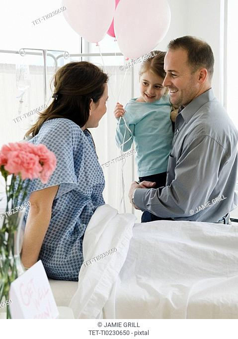 Mother in hospital bed