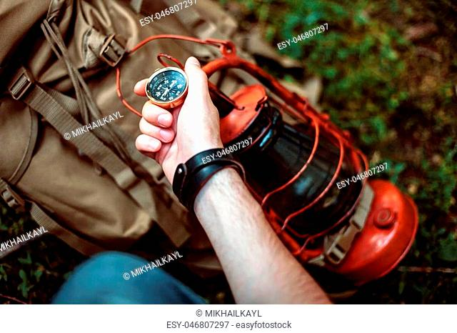 Man holding a compass.The concept of navigation, leisure