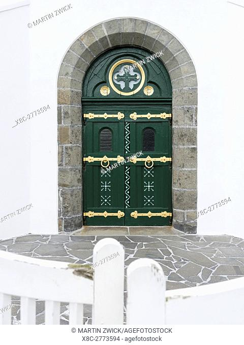 Door of the church. Village Eidi located at the Sundini sound. The island Eysturoy one of the two large islands of the Faroe Islands in the North Atlantic