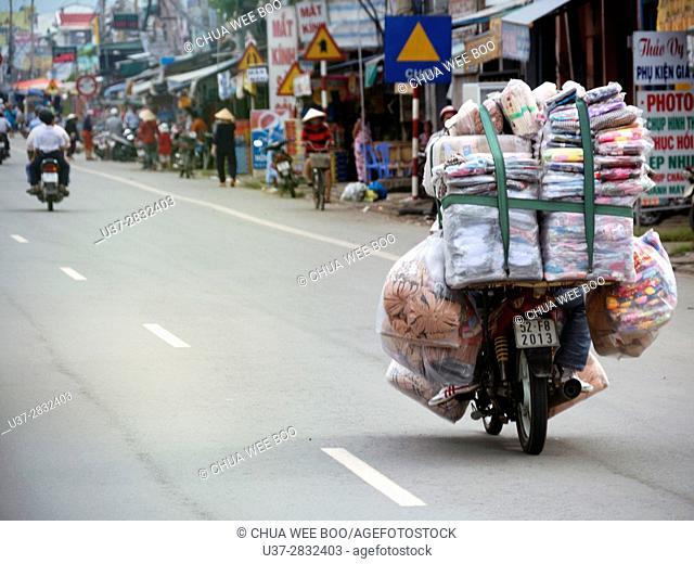 Street setting, moped riders on a street at Saigon, Hoh Chi Minh City, Vietnam, Asia