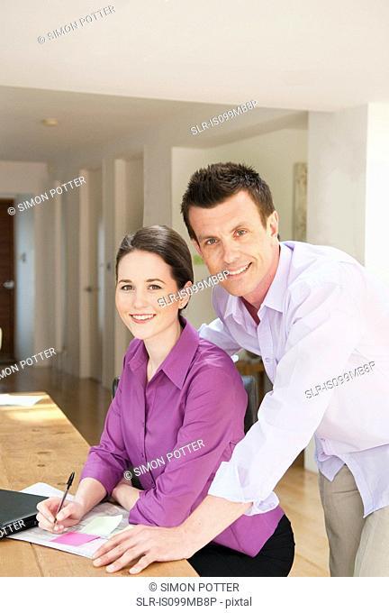 Couple doing paperwork, portrait