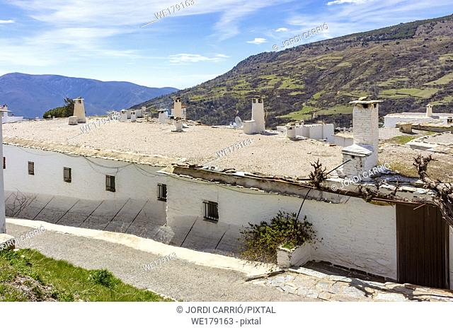 Capileira, Andalusia, Spain: View of the typical houses of the Alpujarra with its upper terraces with chimneys