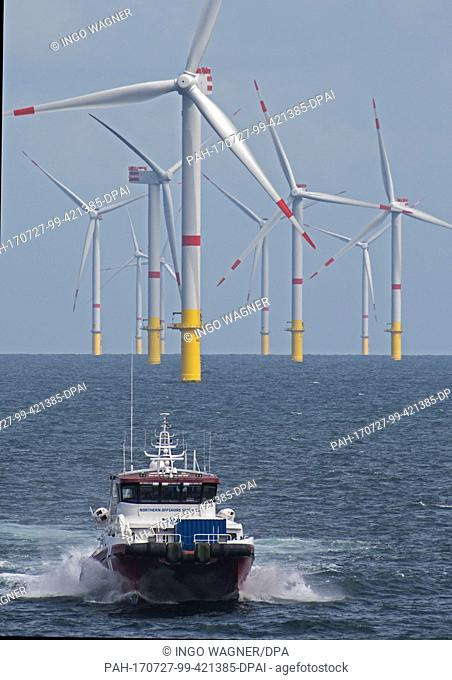 """The boat """"""""Detector"""""""" drives through the offshore wind park """"""""Nordsee 1"""""""" in front of the East Frisian island Spiekeroog, Germany, 27 July 2017"""