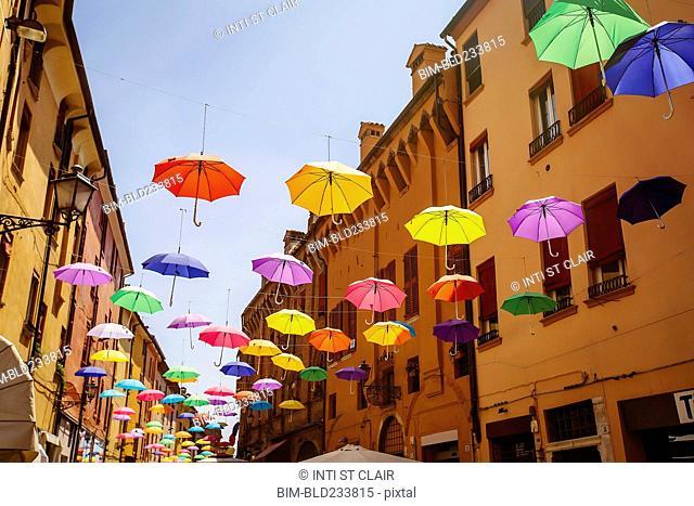 Multicolor umbrellas hanging outdoors, Bologna, Emilia-Romagna, Italy