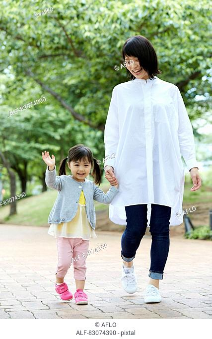 Japanese mother and daughter at a city park