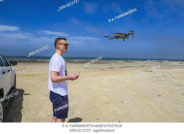 Swakopmund, Namibia. A Swedish tourist fying his drone on the beach