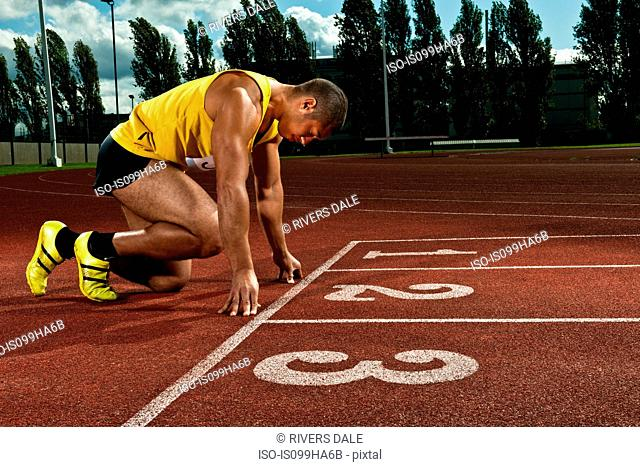 Athlete preparing to race on sportstrack