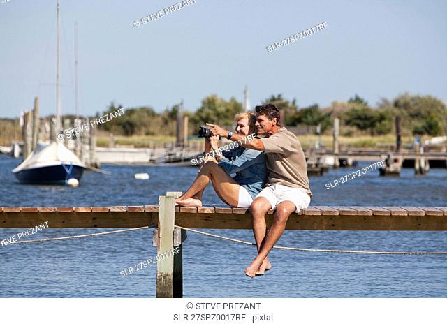 Couple sitting on a dock