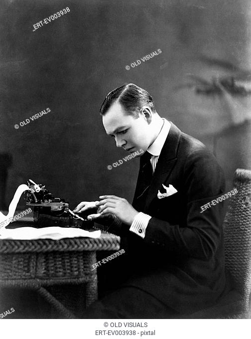 Portrait of man using typewriter All persons depicted are not longer living and no estate exists Supplier warranties that there will be no model release issues