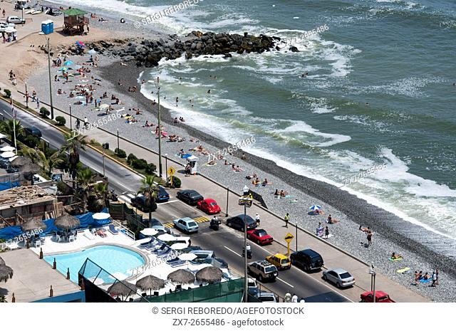 Aerial view of Miraflores beach and its coastal cliffs bordering the Pacific Ocean. Miraflores, Lima, Peru, South America