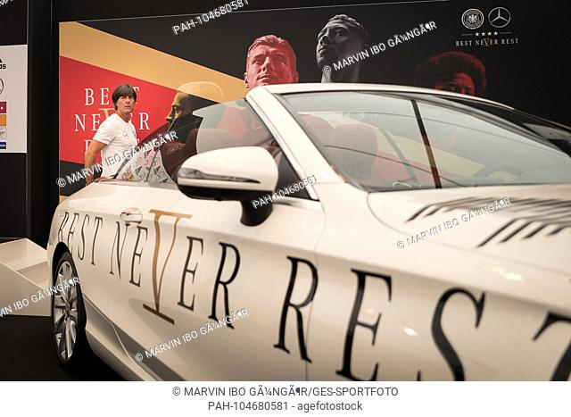 coach Joachim Loew (Germany) runs past a Mercedes car with the inscription Best Never Rest. GES / Football / Preparing for the 2018 World Cup: Press conference...