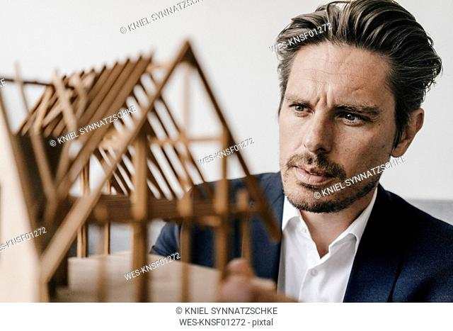 Architect examining architectural model