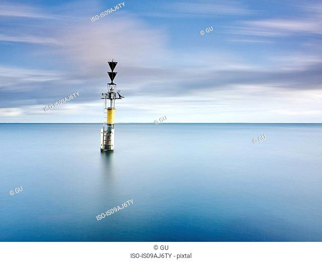 Time exposure of channel marker, sea and clouds, Fremantle, Western Australia