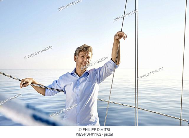Portrait of mature man on his sailing boat