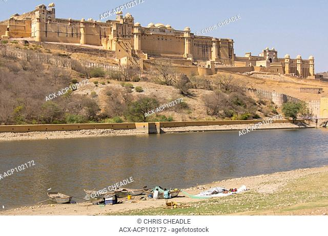 Lakeside boats below Amer Fort which is located in Amer, near Jaipur, Rajastan, India