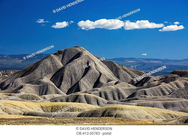 Blue sky and clouds over Badlands, Colorado, United States