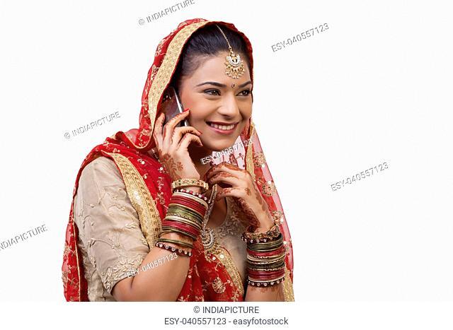 Gujarati bride talking on a mobile phone