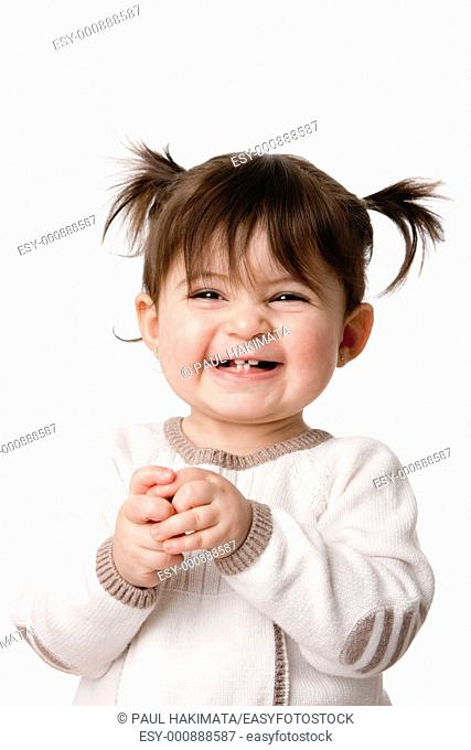Beautiful expressive adorable happy cute laughing smiling baby infant toddler girl with ponytails showing teeth, isolated