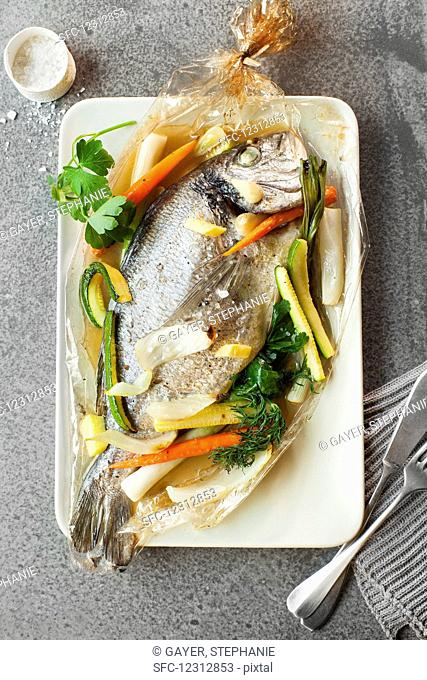 Sea bream in an oven bag with vegetables