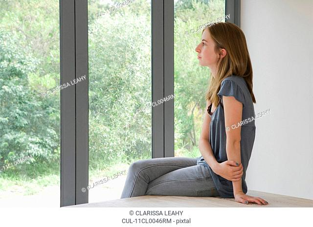 Woman looking out of folding doors