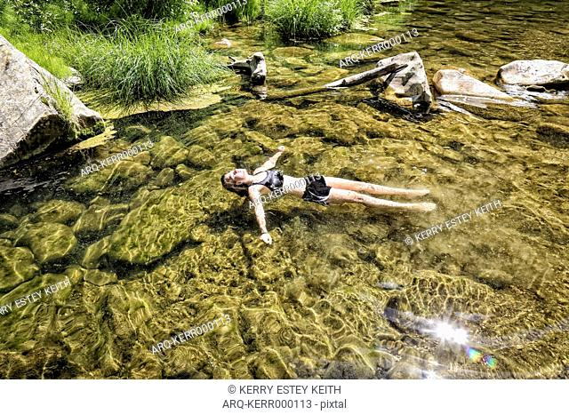 Girl Floats Peacefully In The West Clear Creek, Coconino National Forest, Arizona