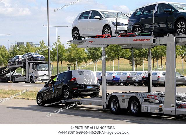 15 August 2018, Germany, Schoenefeld: Unauthorised Volkswagen vehicles are unloaded and parked in a parking lot at BER Airport