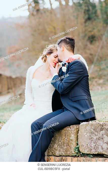 Portrait of bride and bridegroom on country lane