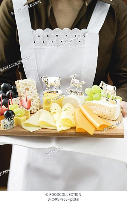 Waitress serving a cheese platter