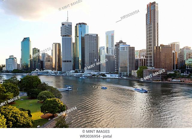 Skyline of city by the ocean, with skyscrapers and boats on the river