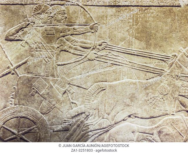 London, UK - April 14th, 2002: Ashurnasirpal hunting lions from chariot. Nimrud Palace stone reliefs. British Museum, UK. Digitise film photo