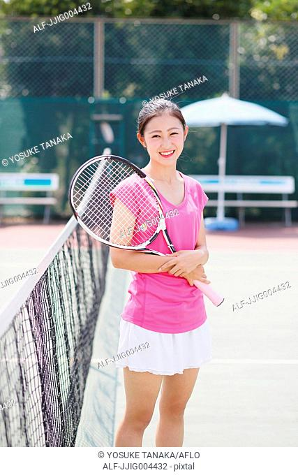Young Japanese tennis player on the court