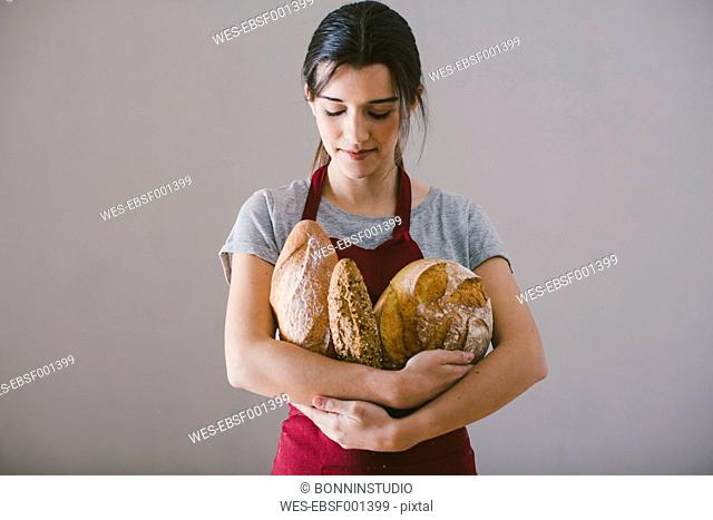 Woman with hand made bread