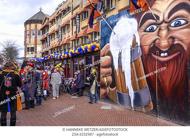 People wearing costumes and drinking beer during carnival in Eindhoven, The Netherlands, Europe