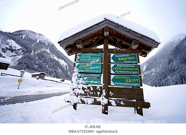 Austria, Tyrol, Stubaital, Neustift, signs for hotels and holiday apartments, snowy, winter