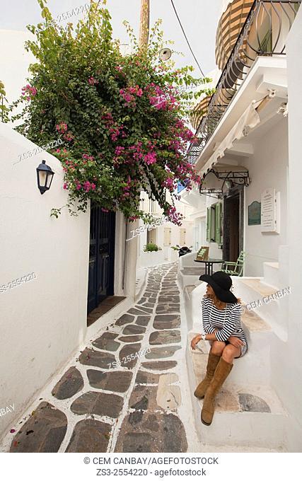 Woman posing in the alleys of town center, Mykonos, Cyclades Islands, Greek Islands, Greece, Europe