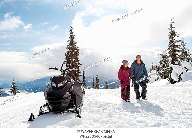 Couple walking together in snowy alps