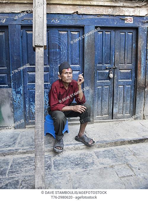 Sitting and smoking, Kathmandu, Nepal