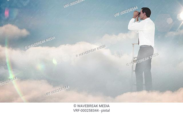 Businessman on ladder looking away with binoculars on blue sky background