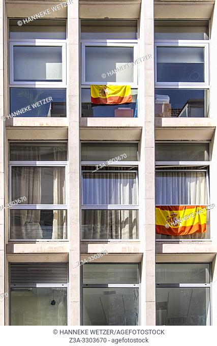 Spanish flags hanging from balconies in Las Palmas de Gran Canaria, Canary Islands