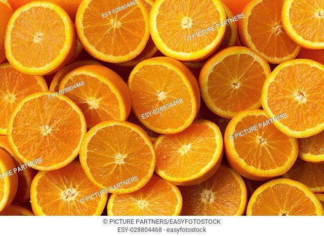 Fresh cut half oranges full frame close up