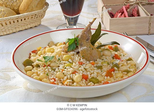 Rice with haricot beans and quail