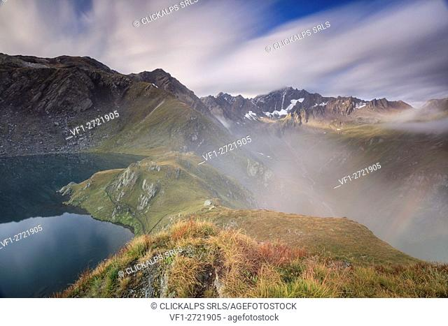 Mist and clouds on high peaks frame the Fenetre Lakes Ferret Valley Saint Rhémy Grand St Bernard Aosta Valley Italy Europe
